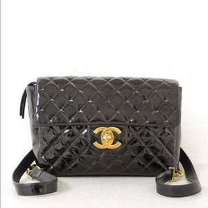 Chanel quilted jumbo patent leather backpack